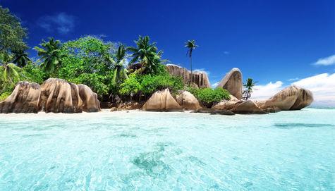 Vykort-stranden Anse Source d'Argent på ön La Digue.